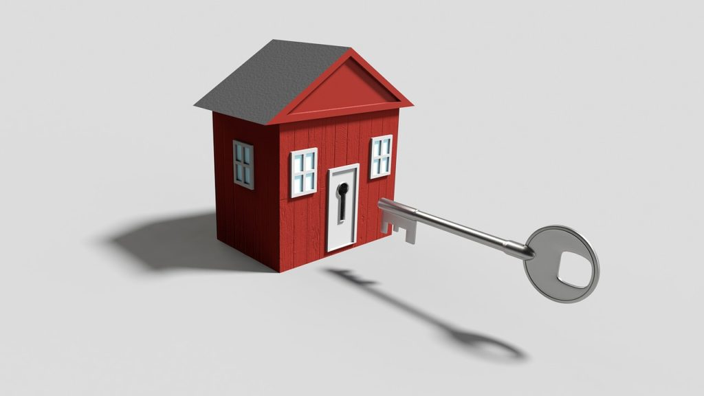 Illustration of a small red house with large silver key in front of it