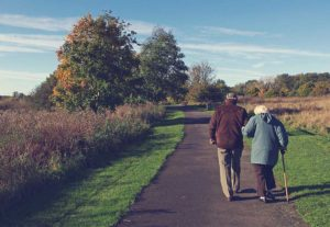 Older couple walking on a nature trail